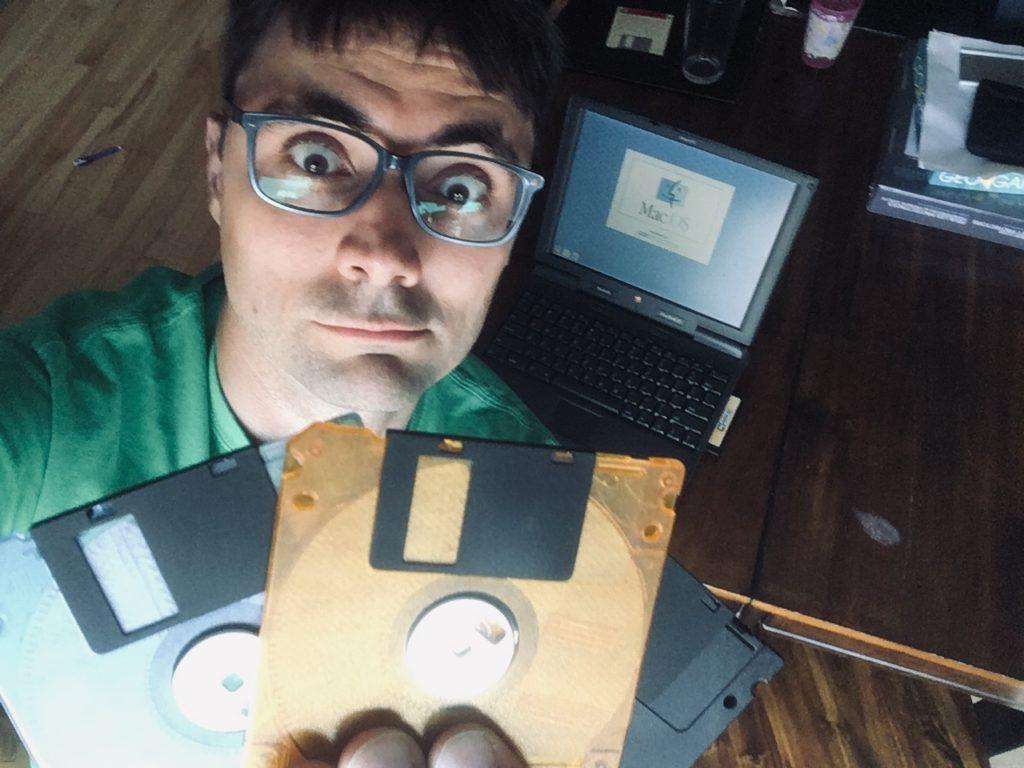 Noah looking at Floppy Disks
