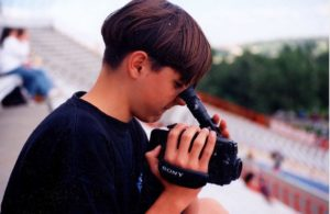Noah as a teenager with a video camera