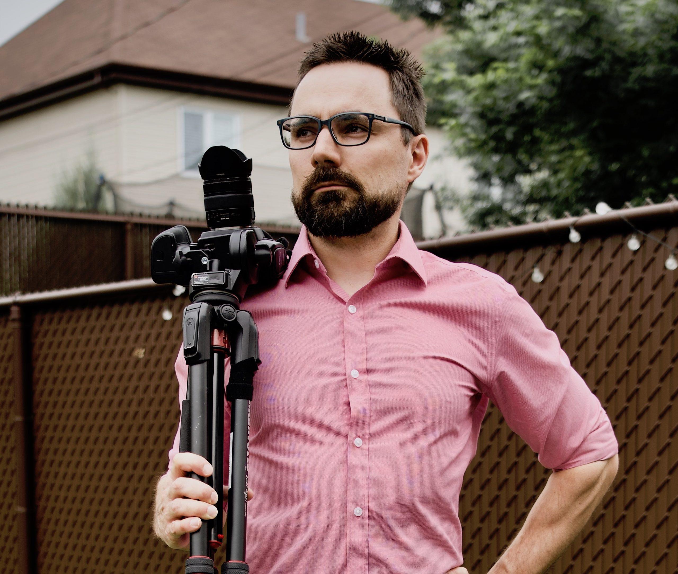 Noah holding a camera