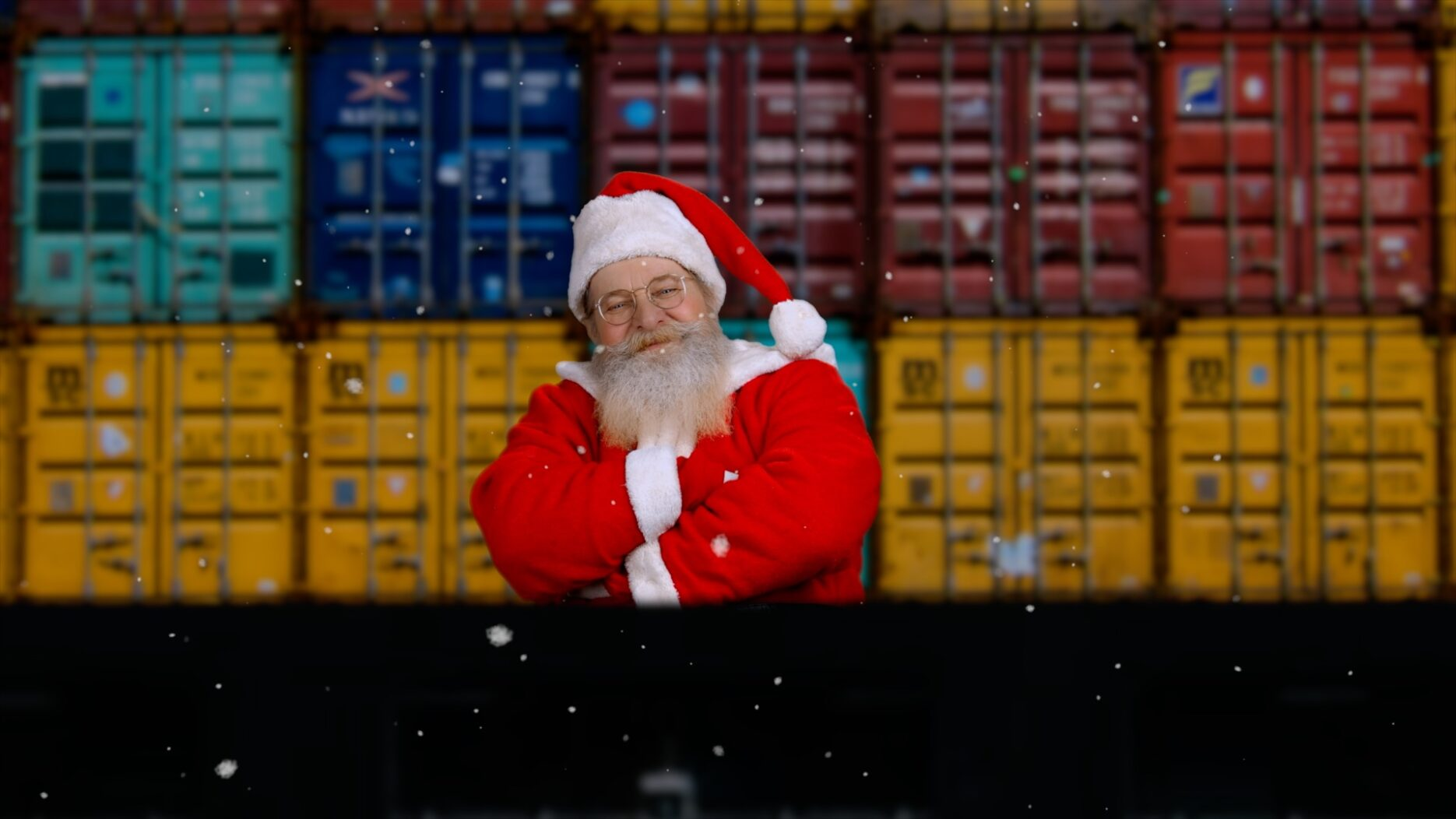 Santa standing on stern of a ship
